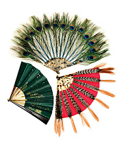 """Photo: DUVELLEROY FANMAKER Exclusively ours. """"Gust of Wind"""" green silk and hand-painted gold flake fan with horn sticks. $775. """"Apache"""" pheasant feather and red silk fan with galalith sticks. $2,450. """"Midnight Bird"""" peacock feather fan with mother-of-pearl sticks. $3,400. France. Seventh Floor. 212 872 2686"""