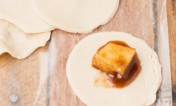 Separate dough into 8 biscuits; cut each into quarters. Flatten each piece and make...