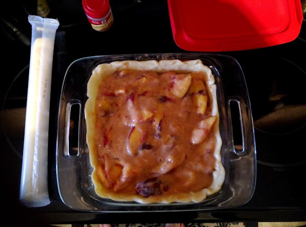 Pour peach mix into the crust. Try to even the filling out over the...