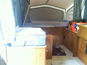 Photo: Stove, tub, toilet beside, full bed