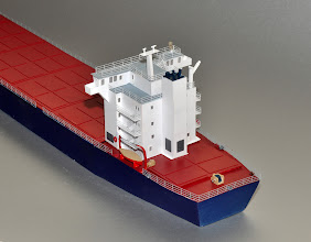 Photo: The stern of the 500-foot 2nd Gen container ship. The rear hatch is designed for 20-foot containers (the TEU standard). By this time the house was designed to a 40-foot length--I'm guessing that allowed ship designers freedom to move it, and the main drive machinery under it, forward if needed. The house is based on a number of containers ships built in the late 1970s for feeder traffic.