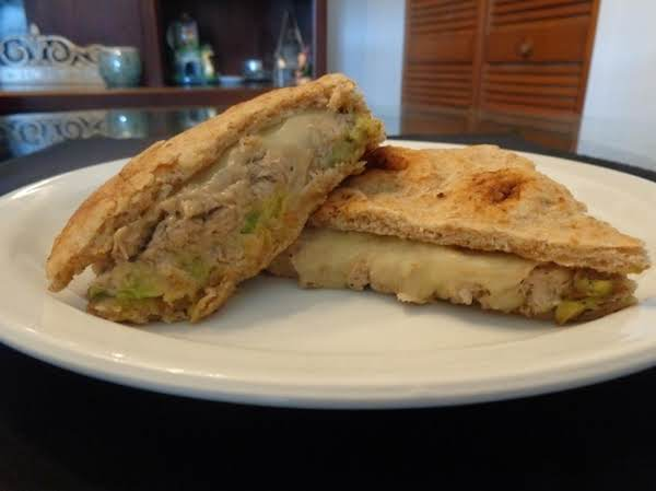 Indian Twisted Tuna Melt With Naan Bread. Tuna (canned) Seasoned With Cumin, Garlic Salt, Pepper And Mayonnaise, Butter Flavored Avocado And Mozzarella Cheese. Broil Until Cheese Melt. Cheesy Little Bit Spicy Indian Flavored Tuna Melt.