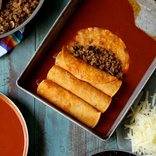 Beef Enchiladas with Green Olives and Raisins