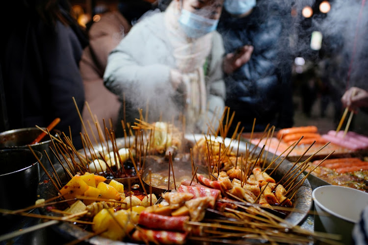 Local snacks are seen at a street market almost a year after the global outbreak of the coronavirus disease (Covid-19) in Wuhan, Hubei province, December 6, 2020.