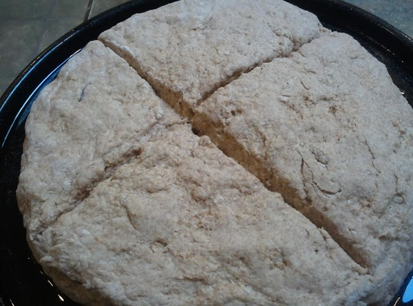 Place on baking sheet and then make a deep cross in top of bread...