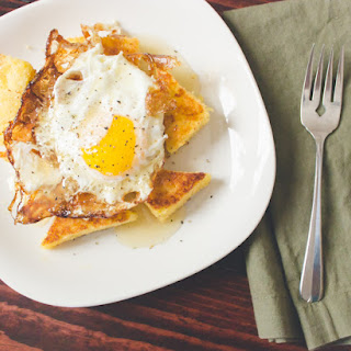 Crispy Fried Egg + Cornbread With Orange Peel And Honey Butter Drizzle.