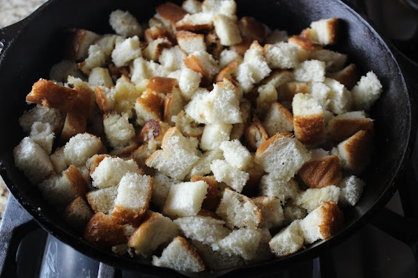 Melt 3 Tbsp of butter in the skillet and add the cubed bread. Gently...