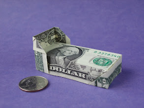 Photo: Model: George Washington Slept Here;  It's a bed, haha;  Creator: Gay Merrill Gross;  Folder: William Sattler;  1 dollar;  Publication: Dollar Bill Origami (John Montroll) ISBN 0-486-42982-2