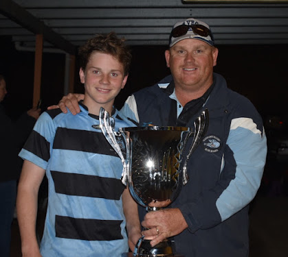Narrabri Blue Boars under-14s captain Joey Fowler and his father and team co-coach Chris Fowler. The pair are holding the regional under-14 competition cup, which Narrabri won after it defeated Armidale 28-15 in the grand final on Friday night. Joey scored a try and kicked all four of his side's conversions to finish the game with 13 points.
