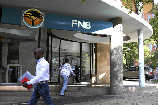 A customer enters an FNB branch in Johannesburg. The bank has been accused of overcharging black homeowners.