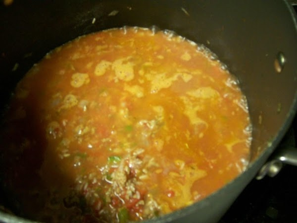 RICEStir in the rice, tomatoes and water.Bring to a simmer, cover and turn to...