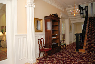 Photo: March 2007: Front Hall looking beautiful! No books on the bookshelf yet.