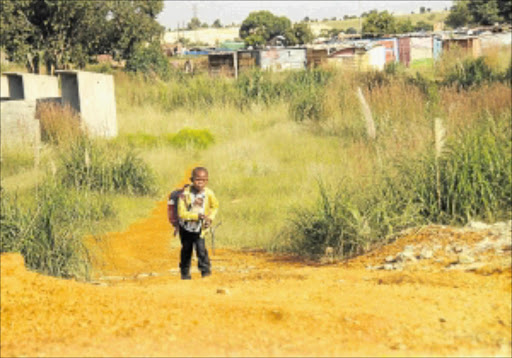 UNSAFE PATH:  A child walks home from school.