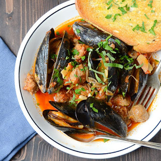 Wine And Garlic Mussels With Sausage.