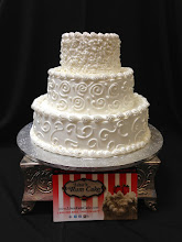 Photo: Wedding cake featuring three different designs: squiggle border (top), swirl & dot (middle), Town&Country (bottom). Traditional borders on tops & bottoms.