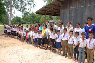 Photo: Accueil par les villageois Ban None Champa
