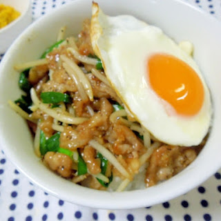 Pork and Bean Sprout Rice Bowl Topped with Fried Egg