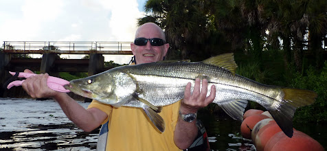 Photo: A happy boy with a nice 40 inch Snook (catch and release)