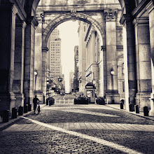 """Photo: """"Through it all...""""  We move slowly towards the light over the cobblestones that the weary feet of all those who have passed over these same paths have passed before us.  And through the archways and doors that sit in our immediate view, the city opens up like so many opportunities that sit every so slightly out of our reach.     This photo was taken and edited with my phone. I am @newyorklens on Instagram (view my feed here: http://goo.gl/8hbcE ). You can check out some of my Instagram photos on Flickr here: http://goo.gl/BxNpG .    Additionally, you can view my phone photography for sale here:http://instaprints.com/profiles/newyorklens.html    New York Photography: 1 Centre Street. Manhattan Municipal Building.    You can view this post along with all relevant links if you wish at my site here:  http://nythroughthelens.com/post/29281559427/looking-through-the-arches-of-the-municipal    Tags: #photography  #nyc  #newyorkcity  #newyorkcityphotography  #city  #urban  #architecture  #iphone  #iphonography  #iphoneography  #mobilephotography  #instagram  #silhouette  #prose  #writing"""