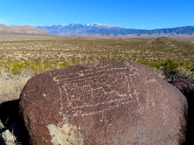 Petroglyph with Sierra Blanca on the horizon