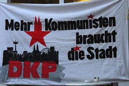 Handgemalte DKP-Leinwand: «Mehr Kommunisten braucht das Land» mit rotem Stern und Köln-Silhouette.