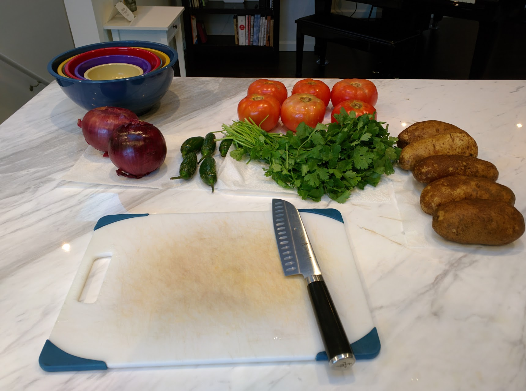 Cutting board, knife, bowls, and veggies