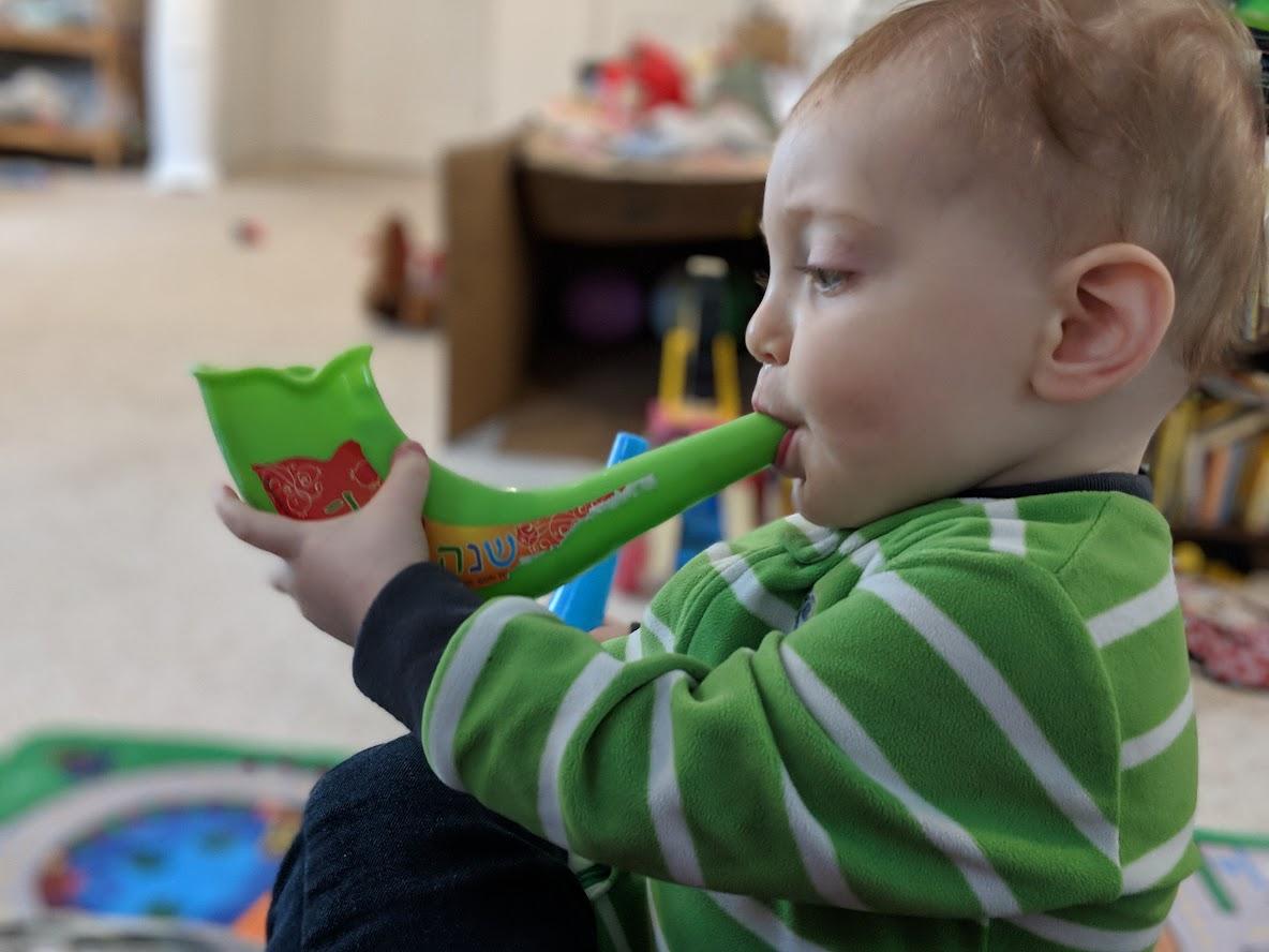 Child playing shofar