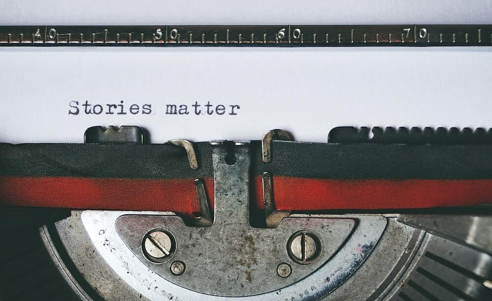 black-and-red-typewriter saying stories matter.jpg
