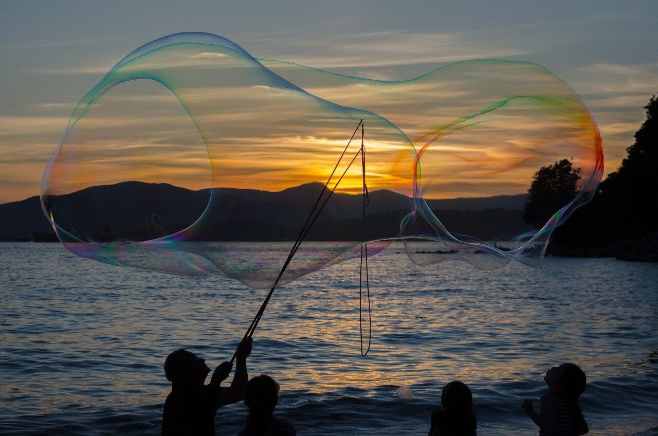 people having at the beach blowing big sized bubbles.jpg