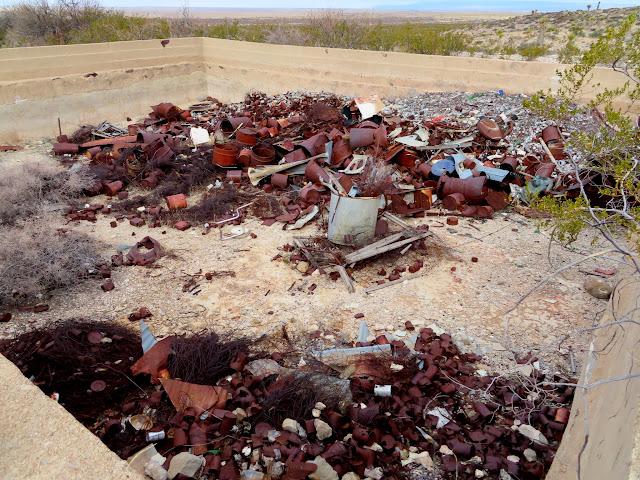 Concrete tank full of trash