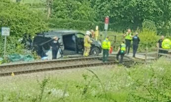 One person injured as train hits van