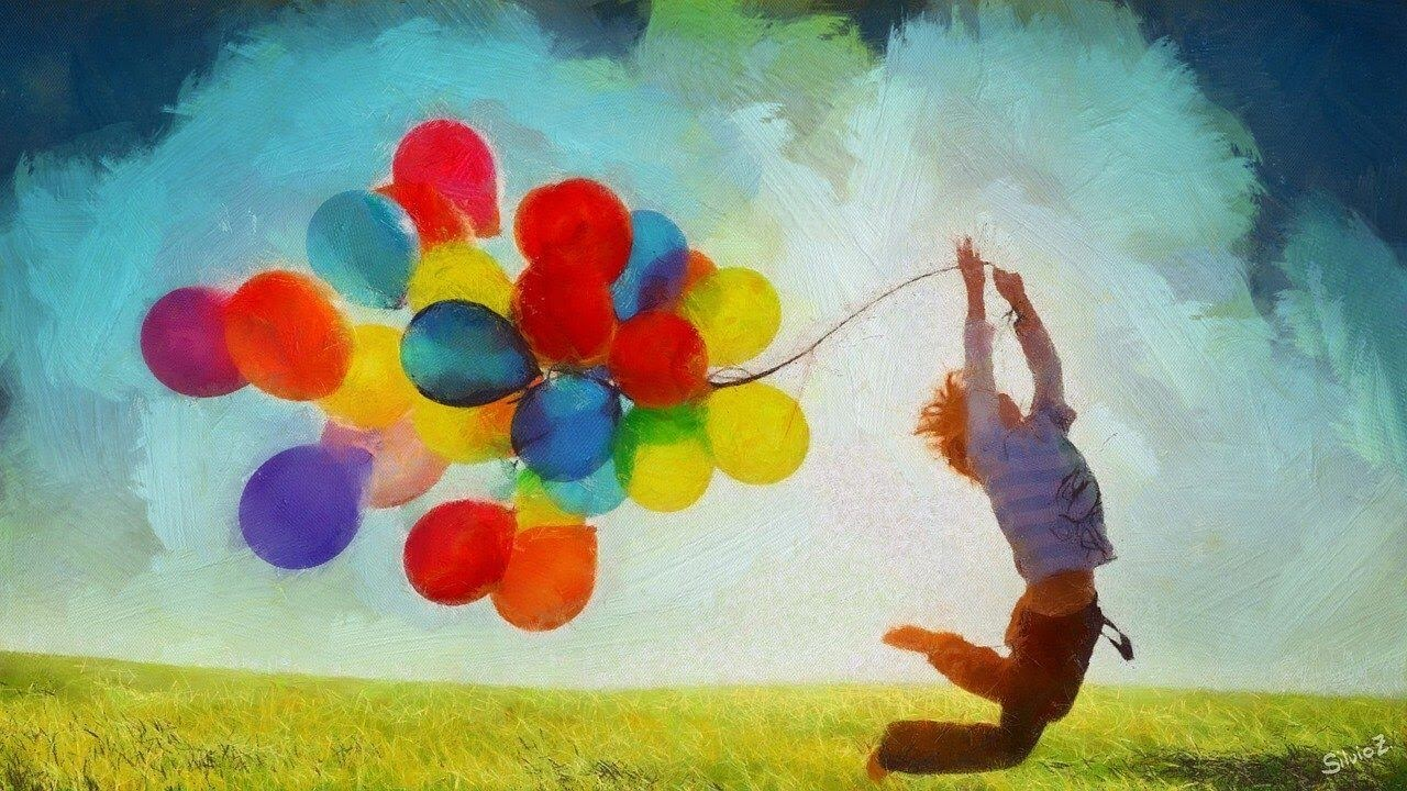 a boy seem happy with colorful balloons.jpg