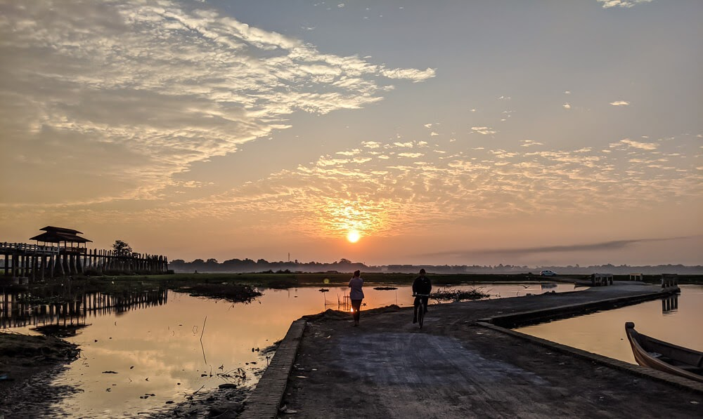 sunrise at myanmar bridge u bein in mandalay.jpg
