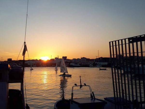 Catania - porto al tramonto - credits Maria Longhitano