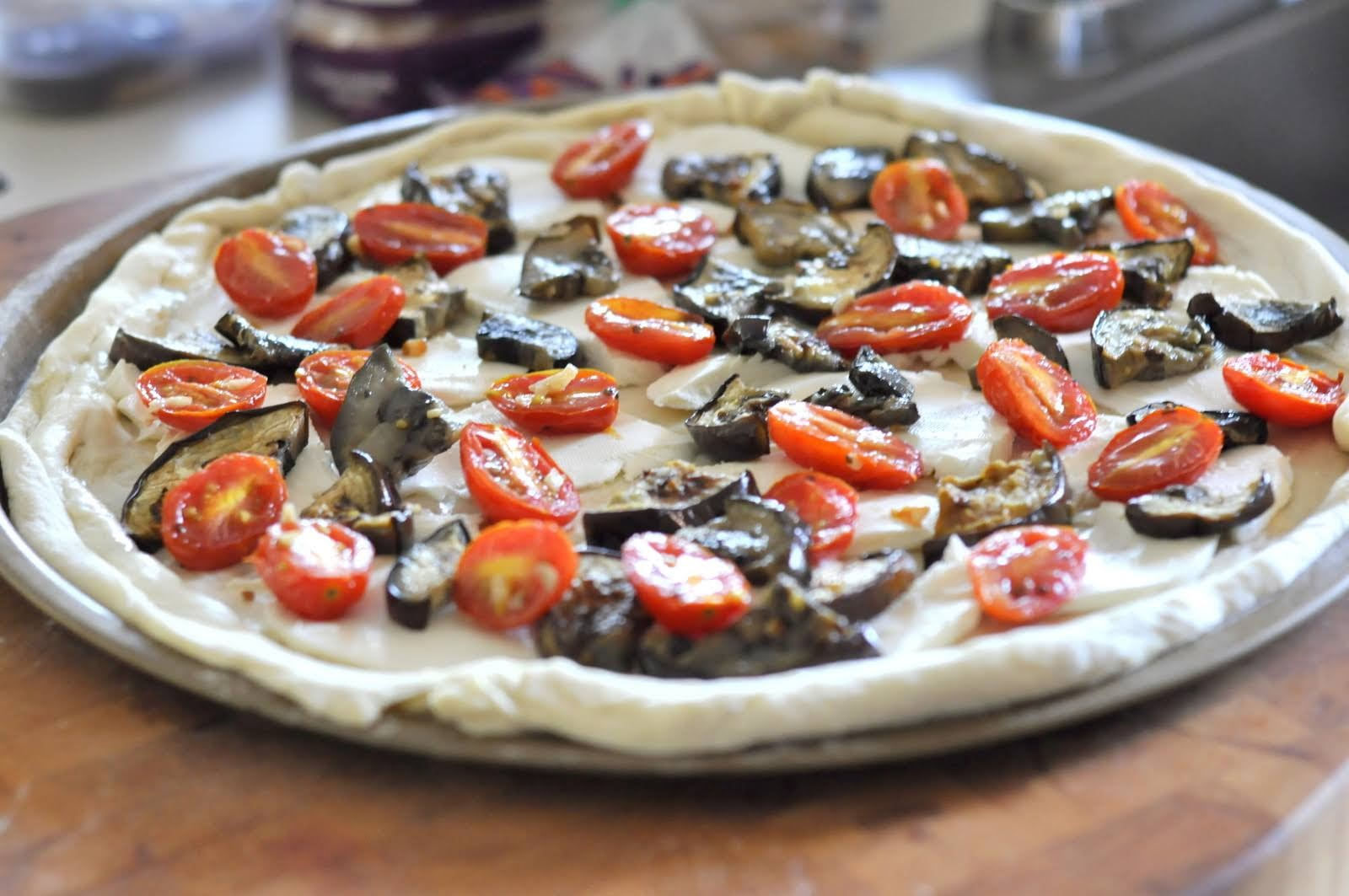 In our house, when I'm at a loss for topping ideas for Pizza Night, we generally turn to this family-favorite -- Pizza with Eggplant, Grape Tomatoes, and Fresh Mozzarella! Get the recipe on Taste As You Go!