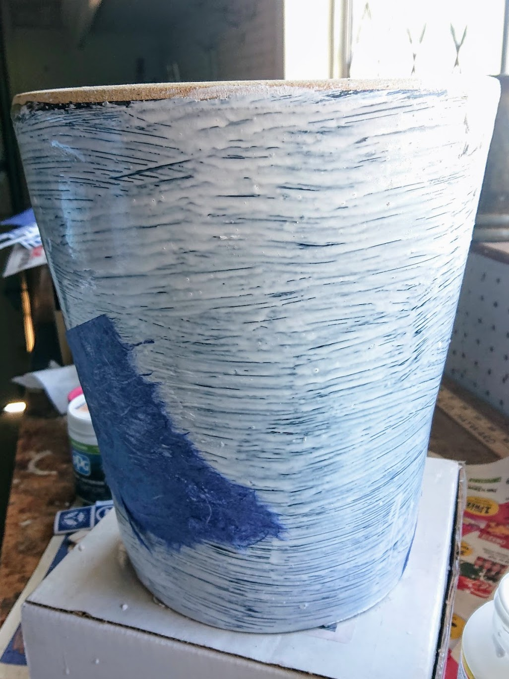 Chipped ceramic planter got caulked, primed, and decoupaged with washi paper pieces. | FAFAFOOM STUDIO