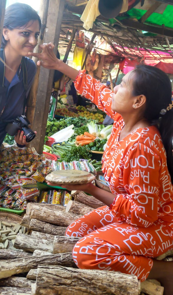 lady applying thanaka to the author in dala market burma.jpg