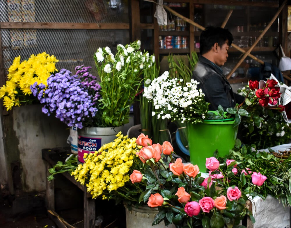flower seller in dala village yangon burma.jpg