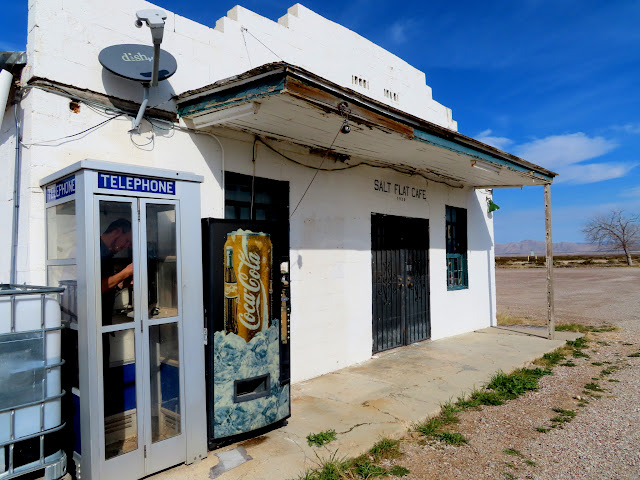 Finding a geocache in a phone booth at the Salt Flat Cafe
