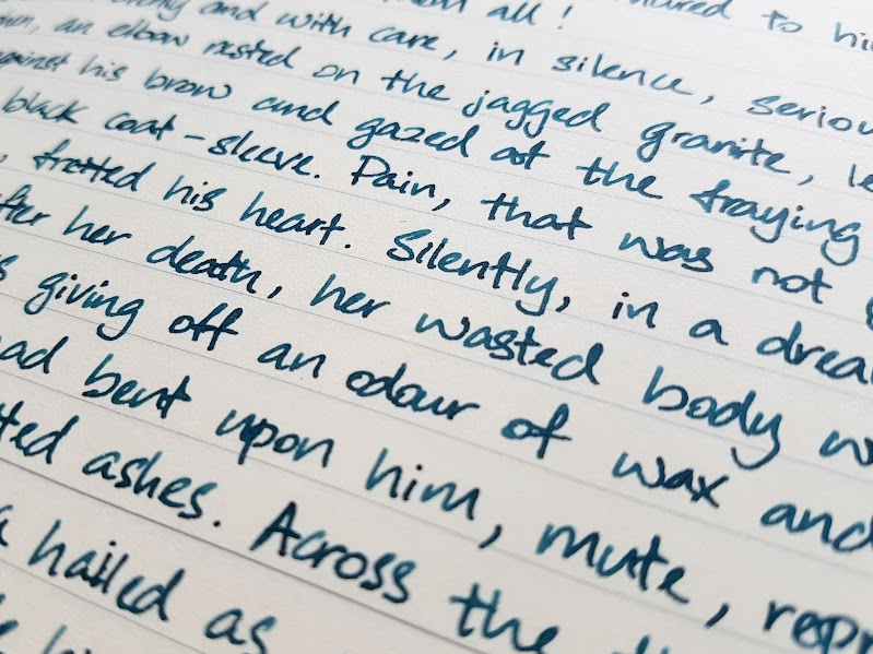 Writing sample of Blackened Seas ink on Midori MD paper