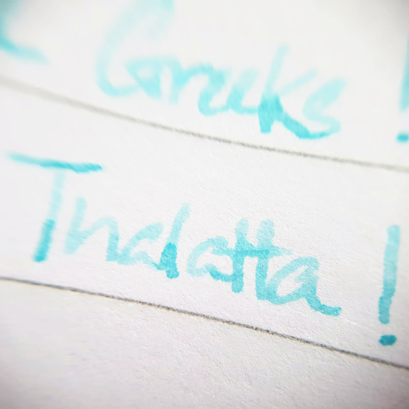 Close up of a word written with Pixie Parasols ink on Rhodia 80gsm paper