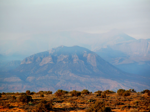 Bull Mountain and Mount Ellen obscured by smoke from a prescribed fire near Monroe Mountain