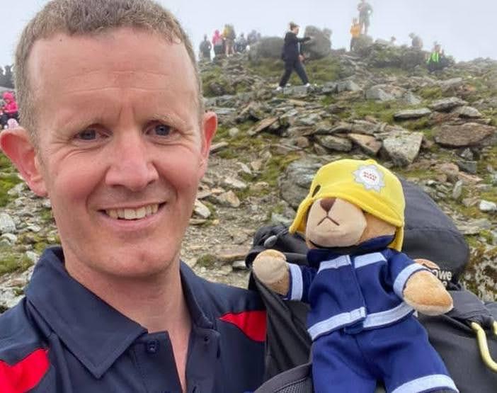 Local fire officer raises charity cash on Snowdon challenge