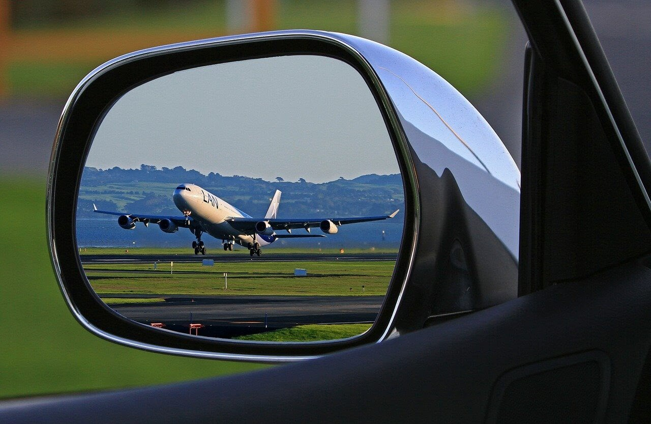 a latam plane in a car window chile travel tips.jpg