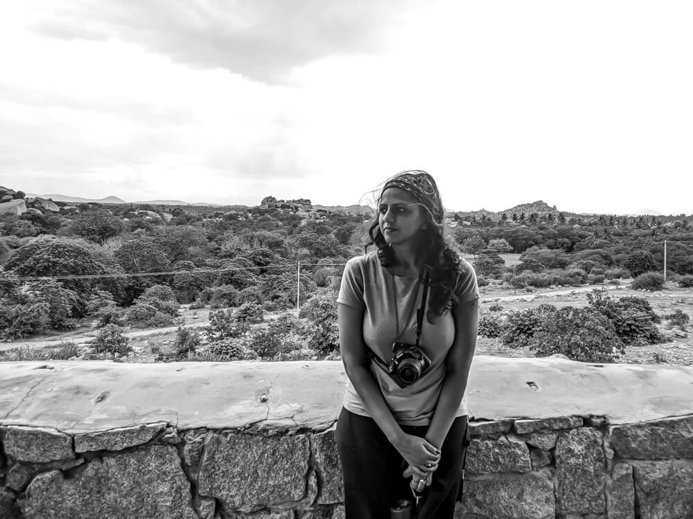 sitting on a stone fence hampi pictures.jpg