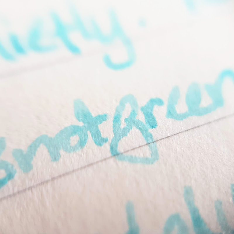 Close up of a word written with Pixie Parasols ink on Midori MD paper