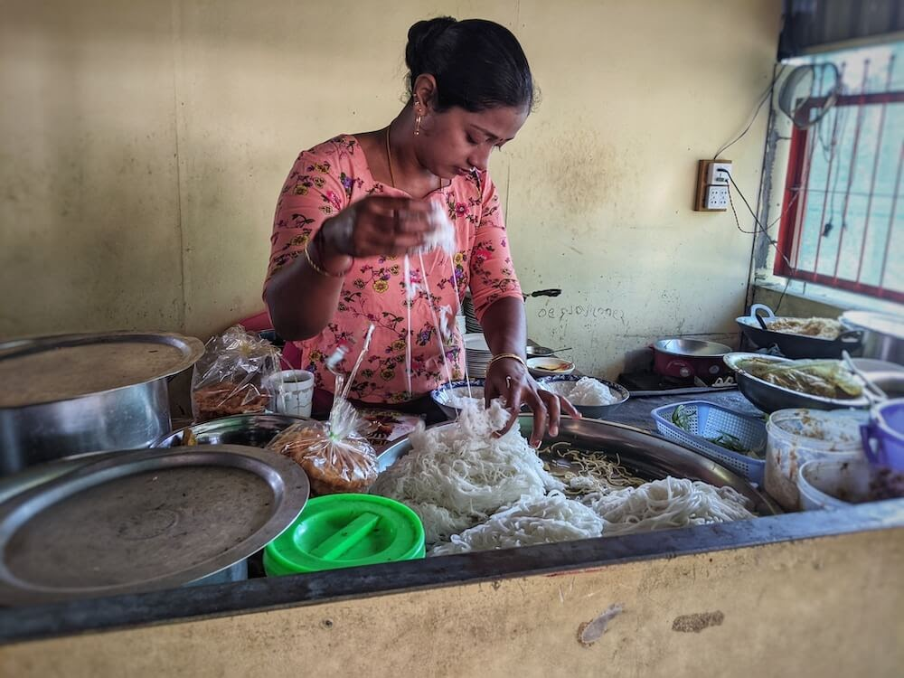 woman making mohinga in dala local market small.jpeg