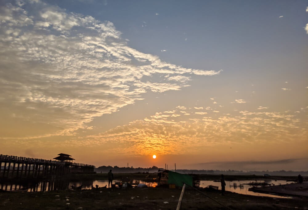sun rising up horizon near mandalay myanmar.jpg
