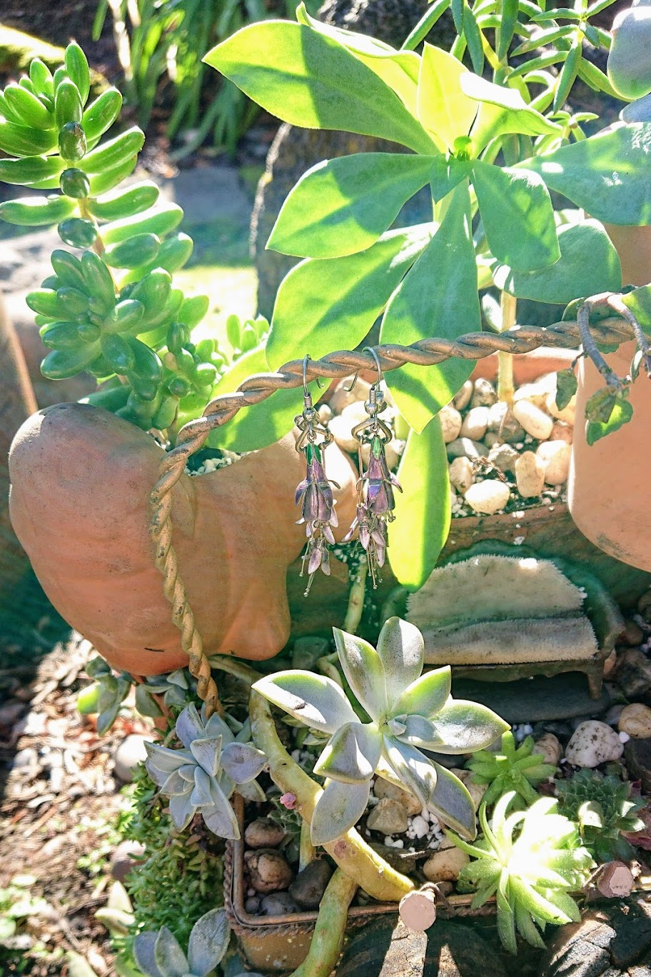 Light purple earrings hanging on the arch of fairy garden. | FAFAFOOM STUDIO