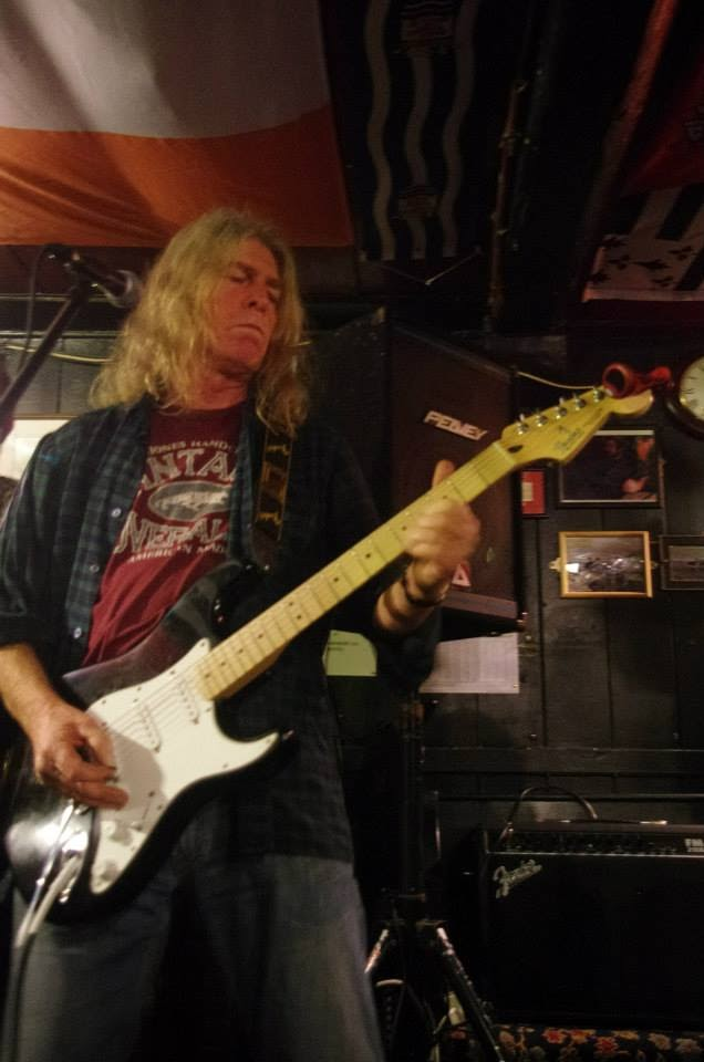 Mark Hankins sometimes plays caveman rock and roll with a few others at the local pub, just to keep the old larynx and fingers working!